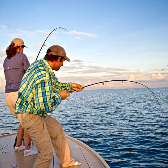 fisherman using a fly rod and a spinnning tackle rod in charlotte harbor